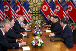 FILE - In this Feb. 28, 2019, file photo, U.S. President Donald Trump, third from left, speaks with National Security adviser John Bolton, left, and Secretary of State Mike Pompeo, second from left. during a meeting with North Korean leader Kim Jong Un, second from right, in Hanoi, Vietnam. Kim is cautiously turning up the heat after his unsuccessful summit with Trump in Hanoi two months ago. Though Kim claims he still has a good personal relationship with the U.S. president, he and senior North Korean officials have shown increasing frustration with Trump's top advisers, Pompeo and Bolton. (AP Photo/ Evan Vucci, File)