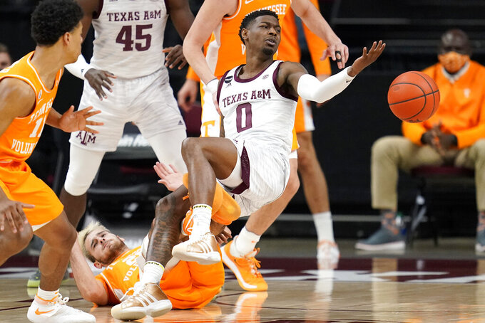 Tennessee guard Santiago Vescovi (25) draws a charging foul on Texas A&M guard Jay Jay Chandler (0) during the first half of an NCAA college basketball game Saturday, Jan. 9, 2021, in College Station, Texas. (AP Photo/Sam Craft)