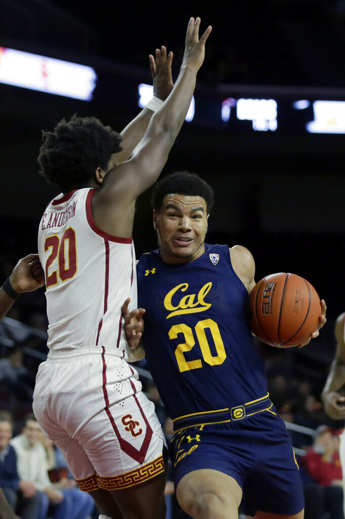 California guard Matt Bradley, right, collides with Southern California guard Ethan Anderson, left, during the first half of an NCAA college basketball game in Los Angeles, Thursday, Jan. 16, 2020. (AP Photo/Alex Gallardo)