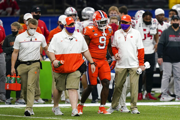 Clemson running back Travis Etienne leaver the field after getting hurt during the first half of the Sugar Bowl NCAA college football game against Ohio State Friday, Jan. 1, 2021, in New Orleans. (AP Photo/Gerald Herbert)