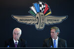 Penske Corporation Chairman Rodger Penske, left, responds to a question as Hulman & Co. Chairman Tony Hulman George looks on during a news conference at Indianapolis Motor Speedway in Indianapolis Monday, Nov. 4, 2019. Indianapolis Motor Speedway and the IndyCar Series were sold to Penske Entertainment Corp. in a stunning move Monday that relinquishes control of the iconic speedway from the Hulman family after 74 years.  (AP Photo/AJ Mast)