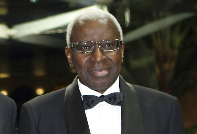 FILE - In this Nov.12, 2011file photo, President of the IAAF (International Association of Athletics Federations) Lamine Diak poses at 2011 World Athletics Gala Awards, in Monaco. French legal authorities have decided to hold a trial for Lamine Diack, once one of the most influential men in Olympic sport, who was disgraced by investigations that uncovered corruption, extortion and doping cover-ups during his 16-year reign as head of the world governing body of track and field. (AP Photo/Claude Paris, File)