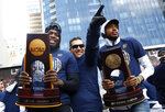 FILE - In this April 5, 2018, file photo, Villanova forward Eric Paschall, left, head coach Jay Wright, center, and guard Mikal Bridges acknowledge fans during a rally following a parade celebrating the team's NCAA college basketball championship in Philadelphia. Wright is starting his 19th season at Villanova, where he is already the winningest coach in program history.(AP Photo/Patrick Semansky, File)