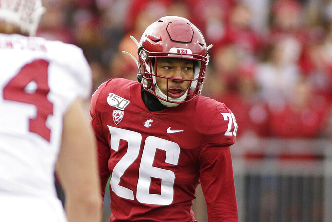 FILE - This Nov. 16, 2019, file photo shows Washington State defensive back Bryce Beekman (26) during the first half of an NCAA college football game against Stanford in Pullman, Wash. Bryce Beekman has died. Police Cmdr. Jake Opgenorth said Wednesday, Marc 25, 2020, the 22-year-old Beekman was found dead at a residence in Pullman. He declined to provide additional details and said more information would be released later by the Whitman County coroner's office. (AP Photo/Young Kwak, File)