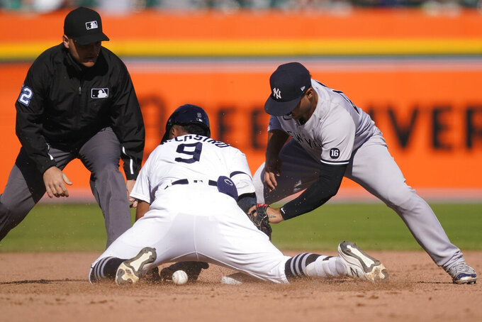 Detroit Tigers second baseman Willi Castro safely reaches second as New York Yankees shortstop Gleyber Torres loses control of the ball during the fifth inning of a baseball game, Saturday, May 29, 2021, in Detroit. (AP Photo/Carlos Osorio)