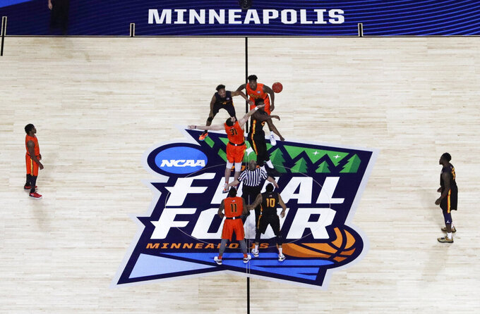 Players get set for the opening tip during the College All-Star Game the Final Four NCAA college basketball tournament, Friday, April 5, 2019, in Minneapolis. (AP Photo/Morry Gash)