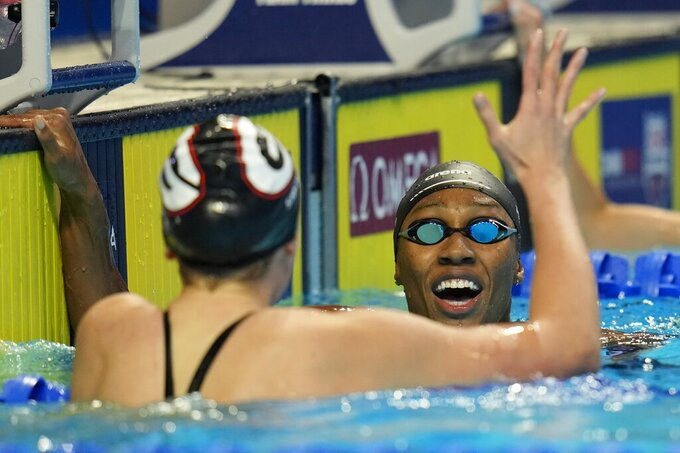 Olivia Smoliga and Natalie Hinds after women's 100 freestyle during wave 2 of the U.S. Olympic Swim Trials on Thursday, June 17, 2021, in Omaha, Neb. (AP Photo/Jeff Roberson)