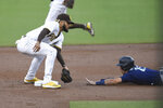 Seattle Mariners' Dylan Moore (25) steals second base past the tag of San Diego Padres shortstop Fernando Tatis Jr. (23) during the first inning of a baseball game Saturday, Sept. 19, 2020, in San Diego. (AP Photo/Denis Poroy)