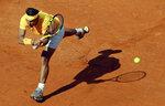 Spain's Rafael Nadal returns the ball to Canada's Denis Shapovalov, at the Italian Open tennis tournament in Rome, Thursday, May 17, 2018 (AP Photo/Alessandra Tarantino)
