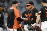 Baltimore Orioles starting pitcher Luis Ortiz (59) is pulled from a baseball game by manager Brandon Hyde, second from left, during the fourth inning of a baseball game against the Boston Red Sox, Friday, June 14, 2019, in Baltimore. (AP Photo/Nick Wass)