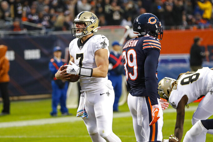 New Orleans Saints quarterback Taysom Hill (7) celebrates a touchdown against the Chicago Bears during the second half of an NFL football game in Chicago, Sunday, Oct. 20, 2019. (AP Photo/Charles Rex Arbogast)