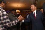 Kweisi Mfume, right, Democratic nominee for Maryland's 7th Congressional District, greets supporters at a victory party, Tuesday, Feb. 4, 2020, in Baltimore. (AP Photo/Gail Burton)