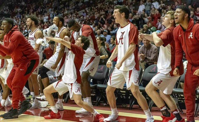 Alabama reacts to a hustle play against Mississippi during the first half of an NCAA college basketball game, Tuesday, Jan. 22, 2019, in Tuscaloosa, Ala. (AP Photo/Vasha Hunt)