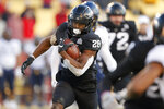 Iowa State running back Breece Hall runs the ball against West Virginia during the first half of an NCAA college football game, Saturday, Dec. 5, 2020, in Ames, Iowa. (AP Photo/Matthew Putney)