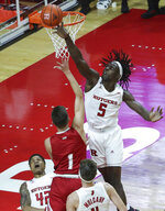 Rutgers center Cliff Omoruyi (5) blocks a shot by Sacred Heart forward Kasparas Jonauskas (1) during the first half of an NCAA college basketball game Wednesday, Nov. 25, 2020, in Piscataway, N.J. (Andrew Mills/NJ Advance Media via AP)