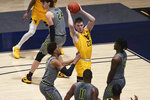 West Virginia guard Sean McNeil (22) passes while defended by Baylor guards MaCio Teague (31), Mark Vital (11) and Davion Mitchell (45) during the second half of an NCAA college basketball game Tuesday, March 2, 2021, in Morgantown, W.Va. (AP Photo/Kathleen Batten)
