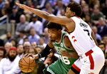 Boston Celtics guard Marcus Smart (36) looks out from under Toronto Raptors guard Kyle Lowry (7) as he tries to drive the ball up court during first half NBA basketball action in Toronto on Tuesday, Feb. 26, 2019. (Frank Gunn/The Canadian Press via AP)