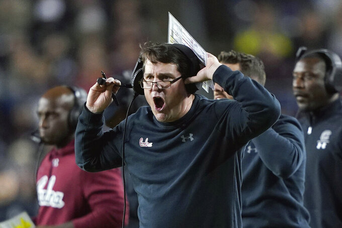 FILE - In this Saturday, Nov. 16, 2019, file photo, South Carolina coach Will Muschamp yells to the officials during the first quarter of an NCAA college football game against Texas A&M, in College Station, Texas. New South Carolina offensive coordinator Mike Bobo will work with a very familiar face this season, his longtime passer at Colorado State in Collin Hill. Gamecocks coach Will Muschamp said Hill will start when his team opens up on Sept. 26 against No. 15 Tennessee. (AP Photo/David J. Phillip, File)