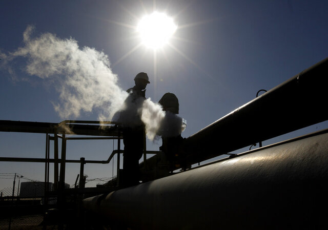 FILE - In this Feb. 26, 2011 file photo, a Libyan oil worker, works at a refinery inside the Brega oil complex, in Brega, eastern Libya. (AP Photo/Hussein Malla, File)