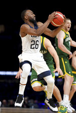 United States' Kemba Walker attempts a shot during their exhibition basketball game against Australia in Melbourne, Thursday, Aug. 22, 2019. (AP Photo/Andy Brownbill)