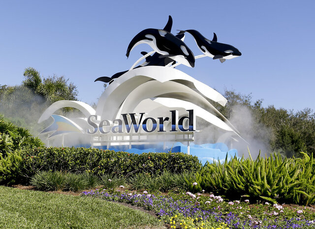 FILE - This Jan. 31, 2017, file photo, shows the entrance to SeaWorld, in Orlando, Fla. Officials from SeaWorld and Disney World say they hope to open their theme parks in Orlando, Fla. in June and July. A city task force approved the plans on Wednesday, May 27, 2020. (AP Photo/John Raoux, File)