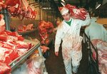 FILE - In this Thursday March 21, 1996 file photo, butcher Graham Poultney carries a leg of beef at London's Smithfield meat market. The European Union banned British beef exports after an outbreak of mad cow disease, prompting one of the biggest fractures in the relationship between Britain and the EU. On Jan. 31, 2020, Britain is scheduled to leave the EU. (AP Photo/Charles Miller, File)
