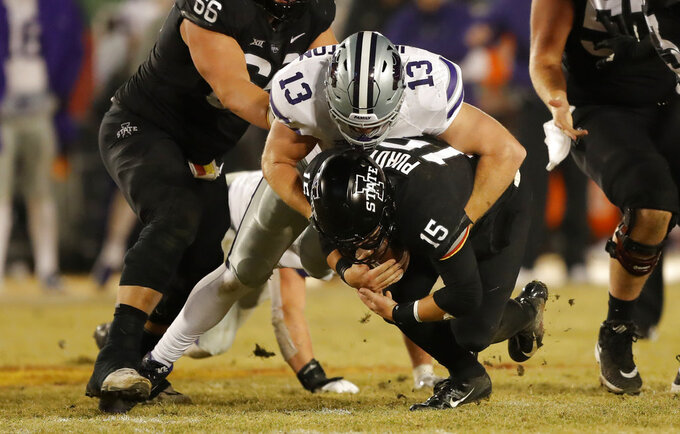 Kansas State defensive end Chase Johnston (13) sacks Iowa State quarterback Brock Purdy (15) during the first half of an NCAA college football game, Saturday, Nov. 24, 2018, in Ames, Iowa. (AP Photo/Charlie Neibergall)