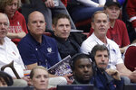 Former NFL quarterback Steve Young, center, watches during the second half of a first-round game in the NCAA women's college basketball tournament between BYU and Auburn in Stanford, Calif., Saturday, March 23, 2019. (AP Photo/Jeff Chiu)