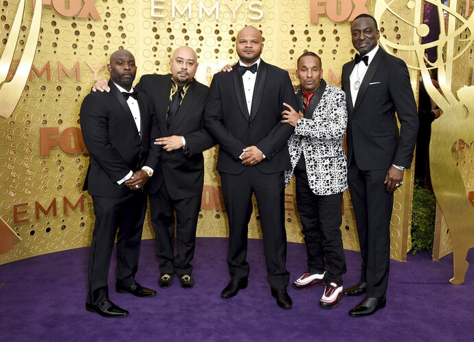 Antron McCray, from left, Raymond Santana, Kevin Richardson, Korey Wise and Yusef Salaam, of the Central Park 5, arrive at the 71st Primetime Emmy Awards on Sunday, Sept. 22, 2019, at the Microsoft Theater in Los Angeles. (Photo by Jordan Strauss/Invision/AP)