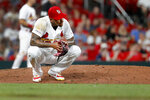 St. Louis Cardinals relief pitcher Carlos Martinez reacts after giving up an RBI single to Pittsburgh Pirates' Colin Moran during the ninth inning of a baseball game Tuesday, July 16, 2019, in St. Louis. (AP Photo/Jeff Roberson)