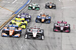 IndyCars begin the Grand Prix of Long Beach auto race into Turn 1 with Josef Newgarden (2) at the pole Sunday, Sept. 26, 2021, in Long Beach, Calif. (AP Photo/Alex Gallardo)