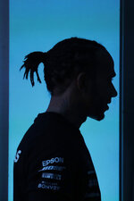 Mercedes driver Lewis Hamilton, of Britain, is silhouetted against a blue background during a news conference in Sao Paulo, Brazil, Wednesday, Nov. 13, 2019. Brazil's Formula 1 GP will take place on Sunday. (AP Photo/Nelson Antoine)