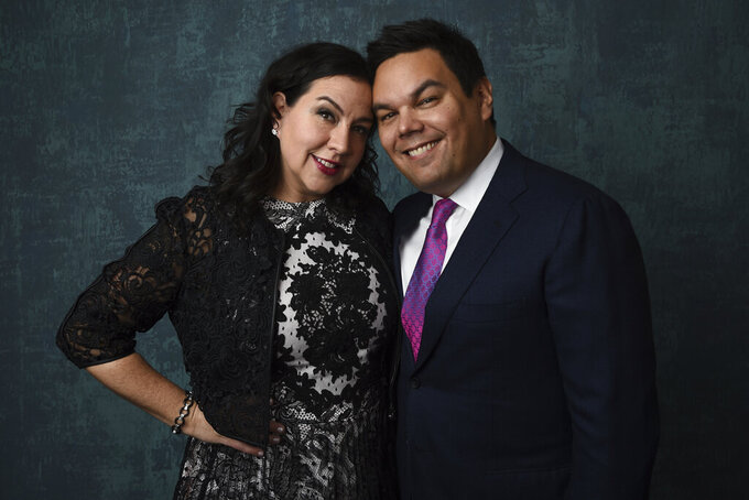 FILE - In this Jan. 27, 2020 file photo, Kristen Anderson-Lopez, left, and Robert Lopez pose for a portrait at the 92nd Academy Awards Nominees Luncheon in Los Angeles. The husband-and-wife songwriting duo of Kristen Anderson-Lopez and Bobby Lopez are just some of the luminaries who have signed on to give master classes and advise fledgling artists as a way to benefit the nonprofit TheaterWorksUSA. (AP Photo/Chris Pizzello, File)