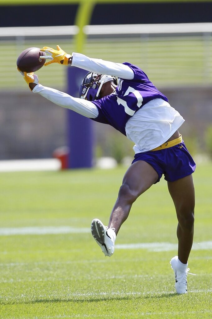 Minnesota Vikings wide receiver Dillon Mitchell reaches for a pass during the NFL football team's training camp which opened with rookies and select veterans Tuesday July 23, 2019, in Eagan, Minn. (AP Photo/Jim Mone)