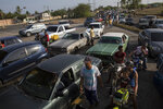 A line of cars spills on to the street as drivers wait to fill their tanks at a fuel station in Cabimas, Venezuela, Sunday, May 15, 2019. U.S. sanctions on oil-rich Venezuela appear to be taking hold, resulting in mile-long lines for fuel in the South American nation's second-largest city, Maracaibo. (AP Photo/Rodrigo Abd)