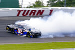 Josh Williams (92) spins out heading into turn one during a NASCAR Xfinity Series auto race at Pocono Raceway, Sunday, June 27, 2021, in Long Pond, Pa. (AP Photo/Matt Slocum)