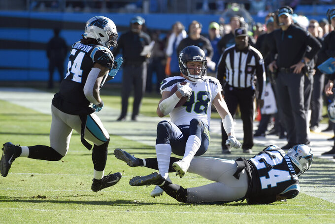 Seattle Seahawks tight end Jacob Hollister (48) is tackled by Carolina Panthers cornerback James Bradberry (24) as Panthers' outside linebacker Shaq Thompson (54) moves in during the first half of an NFL football game in Charlotte, N.C., Sunday, Dec. 15, 2019. (AP Photo/Mike McCarn)