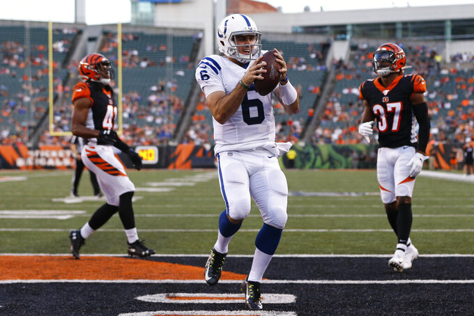 Indianapolis Colts quarterback Chad Kelly (6) celebrates after running in for a touchdown during the first half of the tema's NFL preseason football game against the Cincinnati Bengals, Thursday, Aug. 29, 2019, in Cincinnati. (AP Photo/Frank Victores)