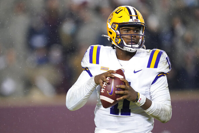 LSU quarterback TJ Finley looks for a receiver during the third quarter of the team's NCAA college football game against Texas A&M, Saturday, Nov. 28, 2020, in College Station, Texas. (AP Photo/Sam Craft)