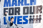 FILE - In this March 24, 2018, file photo, David Hogg, a survivor of the mass shooting at Marjory Stoneman Douglas High School in Parkland, Fla., raises his fist after speaking during the March for Our Lives rally in support of gun control in Washington. March For Our Lives and the Giffords group, two prominent gun safety organizations, say they'll host a forum for Democratic presidential candidates in Las Vegas on Oct. 2, 2019, the day after the second anniversary of the deadliest mass shooting in modern U.S. history. The organizations told The Associated Press that the forum focused on gun violence will be the first of its kind for presidential hopefuls and will be open to all candidates who meet the Democratic National Committee's polling and fundraising thresholds for the September debate. (AP Photo/Andrew Harnik, File)