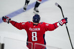 Washington Capitals left wing Alex Ovechkin (8) celebrates his second goal in the third period in an NHL hockey game against the New York Rangers, Wednesday, Oct. 13, 2021, in Washington. Ovechkin's goal gives him 732, and fifth place on the NHL goals list. The Capitals won 5-1. (AP Photo/Alex Brandon)