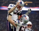 New England Patriots' David Andrews (60) picks up Tom Brady (12) after the Patriots scored a touchdown during the second half of the NFL Super Bowl 53 football game against the Los Angeles Rams Sunday, Feb. 3, 2019, in Atlanta. (AP Photo/Jeff Roberson)