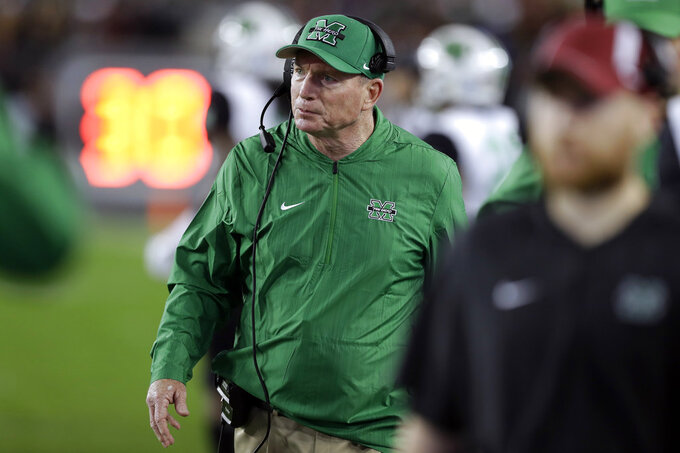 Marshall coach Doc Holliday watches during the first half of the team's Gasparilla Bowl NCAA college football game against South Florida on Thursday, Dec. 20, 2018, in Tampa, Fla. (AP Photo/Chris O'Meara)