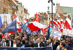 Critics of the European Union march through Warsaw to protest what they call EU's dictate from Brussels, as Poland and other central European nations ceremoniously mark 15 years of membership in the club,in Warsaw, Poland, Wednesday, May 1, 2019.(AP Photo/Czarek Sokolowski)