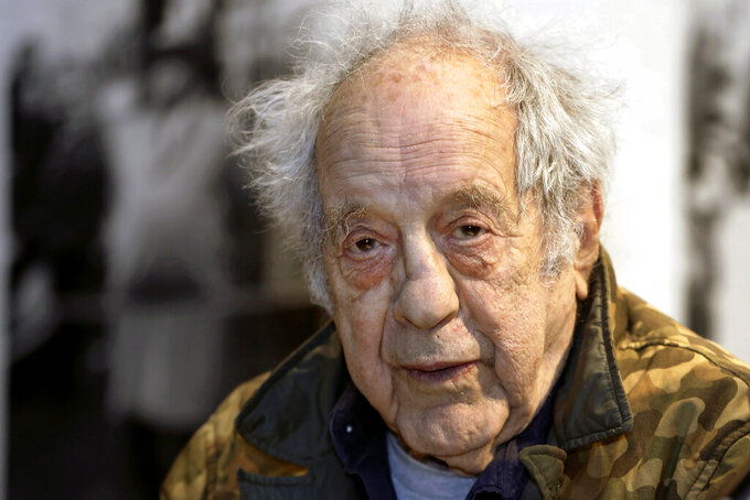 """FILE - In this Jan. 28, 2016, file photo, photographer and filmmaker Robert Frank appears at the opening of the exhibition featuring his work, """"Robert Frank: Books and Films, 1947–2016,"""" at New York University's Tisch School of the Arts in New York. Frank, one of the 20th century's greatest photographers, died at age 94. (AP Photo/Kathy Willens, File)"""