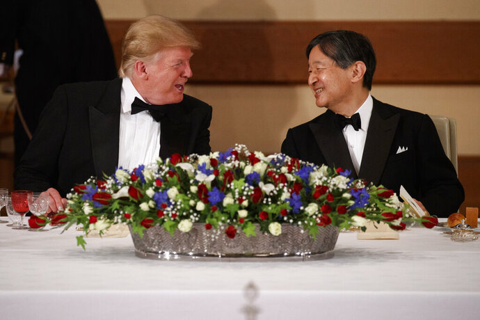 President Donald Trump talks with Japanese Emperor Naruhito during a State Banquet at the Imperial Palace, Monday, May 27, 2019, in Tokyo. (AP Photo/Evan Vucci)