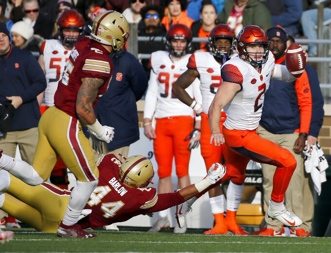Syracuse quarterback Eric Dungey (2) rushes down the sideline ahead of a tackle attempt by Boston College defensive lineman Brandon Barlow (44) during the second half of an NCAA college football game, Saturday, Nov. 24, 2018, in Boston. (AP Photo/Mary Schwalm)