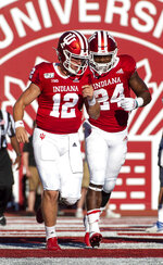 Indiana quarterback Peyton Ramsey (12), left, and running back Sampson James (24) react after the pair connected on a scoring play during the second half of an NCAA college football game Saturday, Sept. 7, 2019, in Bloomington, Ind. Indiana won 52-0. (AP Photo/Doug McSchooler)
