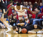 Indiana guard Al Durham (1) tries to avoid falling on top of Purdue guard Sasha Stefanovic (55) after he fell to the court with the ball during the first half of an NCAA college basketball game, Saturday, Feb. 8, 2020, in Bloomington, Ind. (AP Photo/Doug McSchooler)
