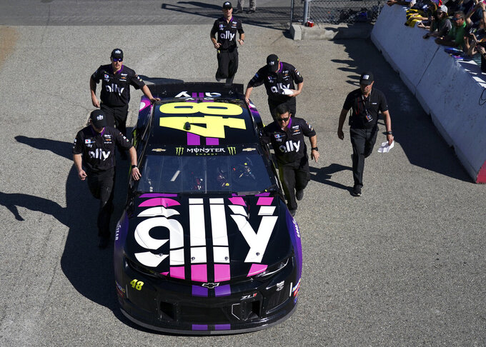 Crew members push Jimmie Johnson's car to the track during the NASCAR Cup Series auto race at Auto Club Speedway, in Fontana, Calif., Sunday, March 17, 2019. (AP Photo/Rachel Luna)